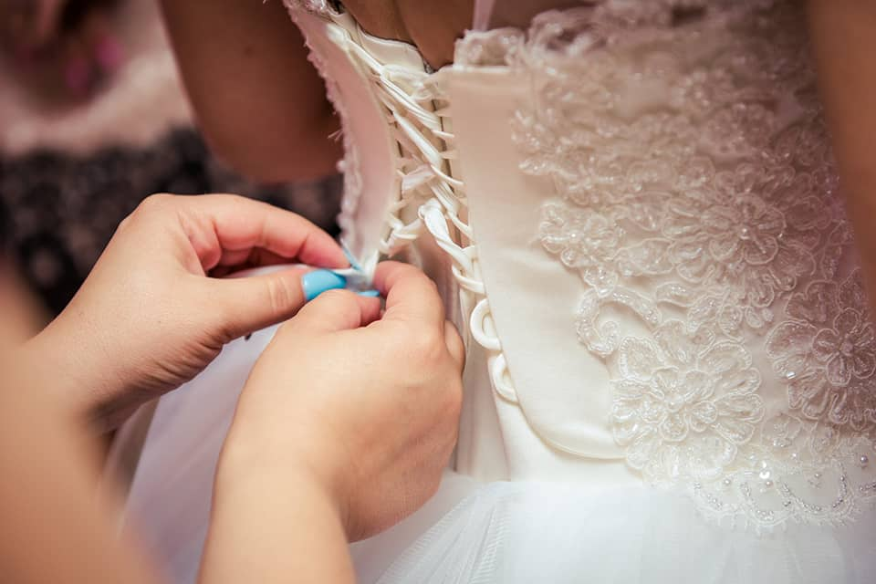 woman fixing the wedding gown