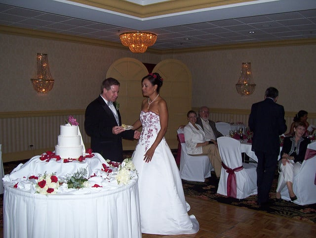 married couple during a wedding cake cutting