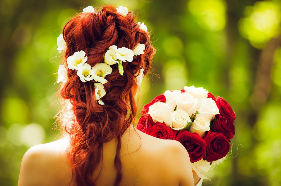 red hair bride and red rose bouquet