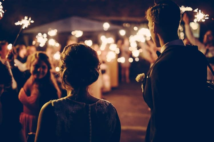 silhouette of man and woman in a wedding party