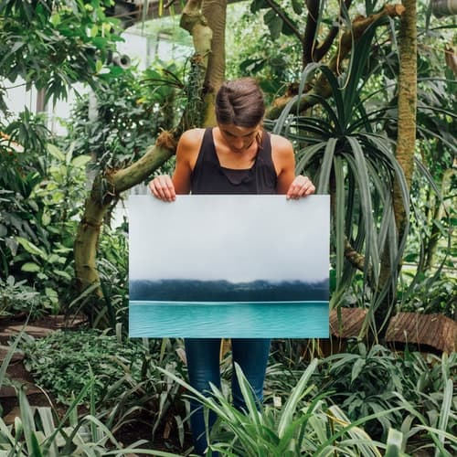 woman holding a painting on canvas