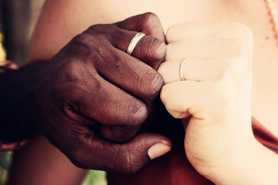 black and white couple's hand