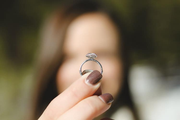 woman holing a ring in focus