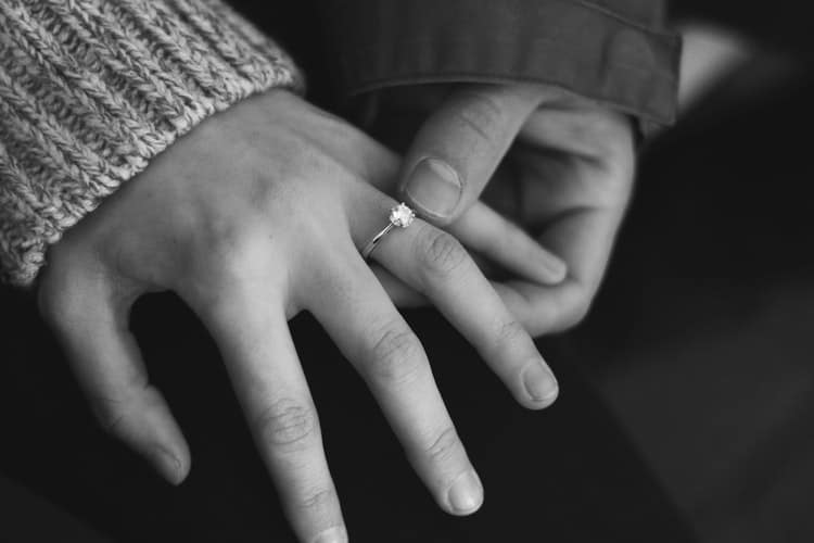 wedding ring on woman's finger