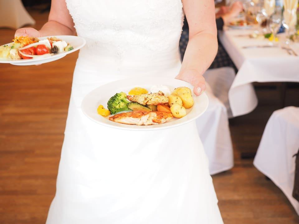bride holding a plate of food