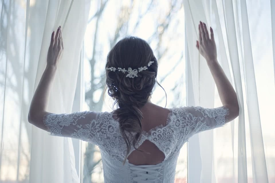 bride opening the curtains