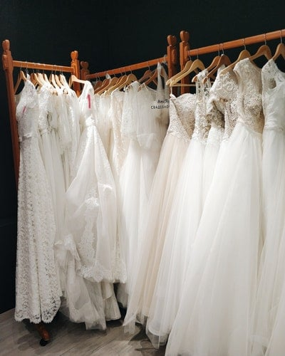 wedding dresses hanged in clothes rack