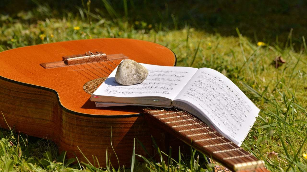 song book on brown classical guitar