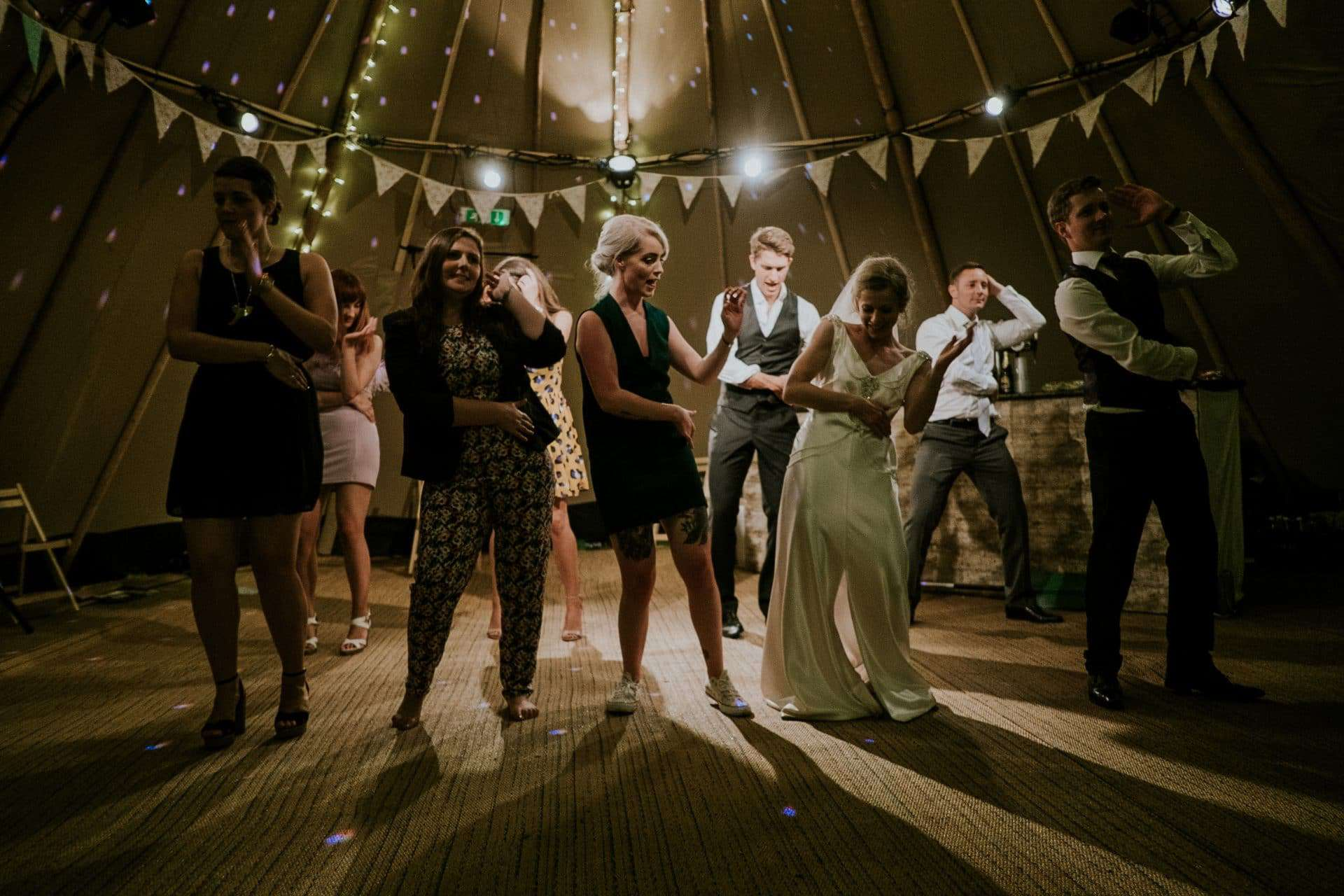 bride and groom and friends dancing
