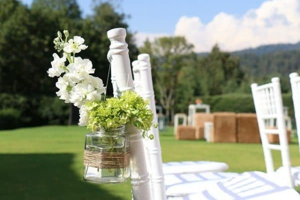 white chairs in a garden wedding