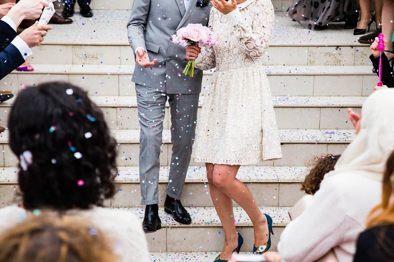 cropped image of a newly wed couple at wedding stairs